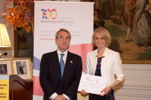 Caroline receiving her award from Mr Philip Paddack of BBVA at the Spanish Embassy in London